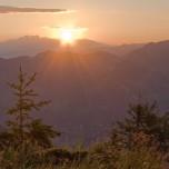 Morgensonne über den österreichischen Alpen